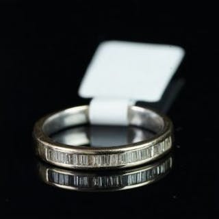 Baguette cut diamond half eternity ring, mounted in unmarked white