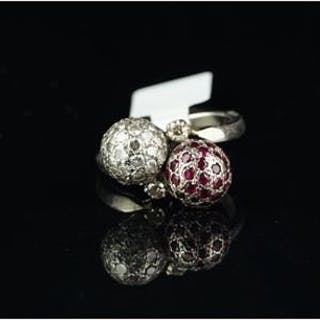 Ruby and diamond crossover ball ring, one set with rubies, the other
