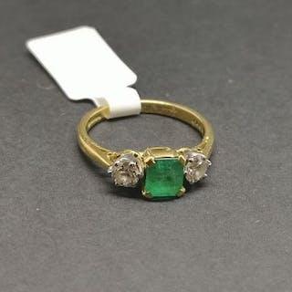 Three stone emerald and diamond ring, central square step cut emerald