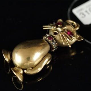 Gem set cat pendant, with marquise ruby eyes and a ruby diamond and