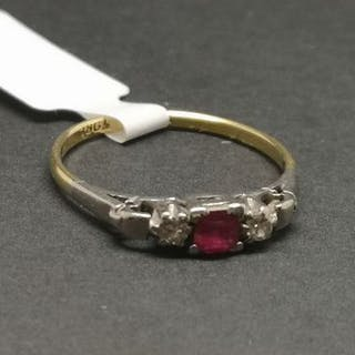 Three stone ruby and diamond ring, mounted in yellow and white metal