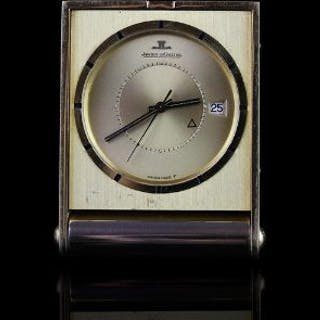 JAEGER -LE COULTRE TRAVEL CLOCK,oblong, champagne dial with black
