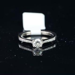 Solitaire brilliant cut diamond ring, with diamond set shoulders