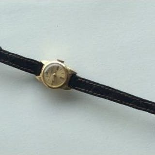 A lady's 18 carat wristwatch on leather strap. App