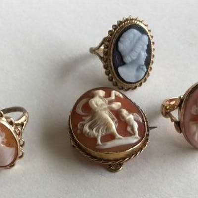 Three 9 carat cameo rings together with a brooch.