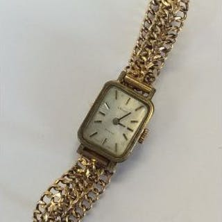 A lady's stainless steel Tissot wristwatch on 18 c