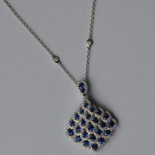 An attractive sapphire and diamond drop pendant wi