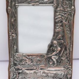 Beaten copper and silver coated frame decorated in relief with HIAWATHA