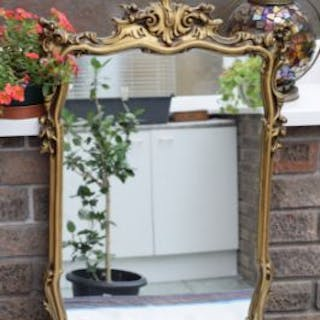 Mirror in rococo style frame measuring 47x66mm...