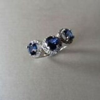 18ct white gold trilogy ring set with 3 round cut sapphires weighing 0.70ct
