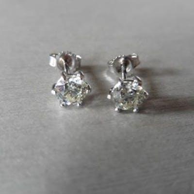 Each set with a brilliant cut diamond