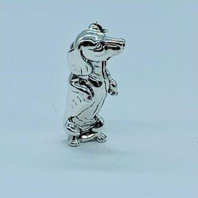 A Silver dog brooch