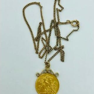 A Half Sovereign in a 9ct yellow gold mount and chain (8.89g)