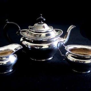 A Silver Batchelors tea set comprising tea set, sugar bowl and milk