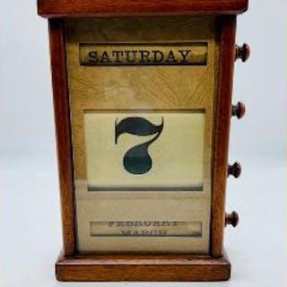 An oak perpetual desk calendar