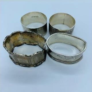 A selection of four various hallmarked silver napkin rings