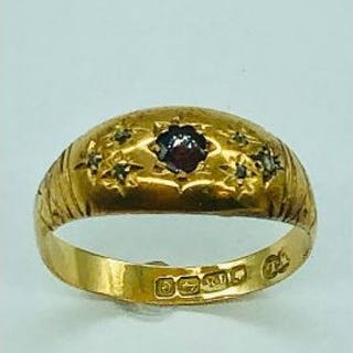 An 18ct yellow gold ring with ruby stone (2.63g)