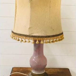 A china and brass based table lamp with fringed shade