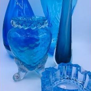 A selection of blue art glass of various shapes