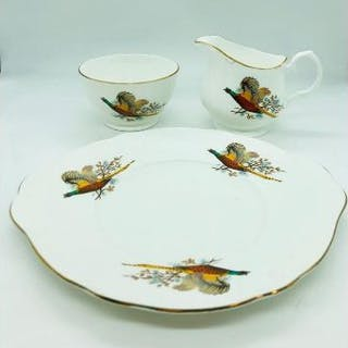 A large plate, milk jug and sugar bowl by Pall Mall Ware with pheasant theme