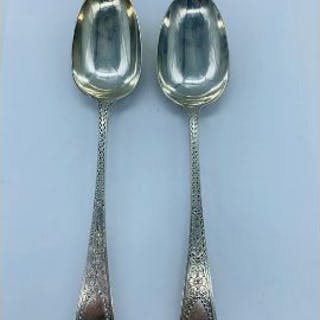 A Pair of Silver hallmarked serving spoons dated Sheffield 1901, makers