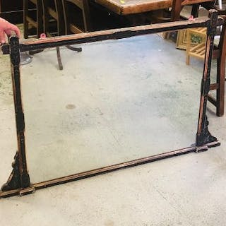 An over mantel black painted wooden mirror AF
