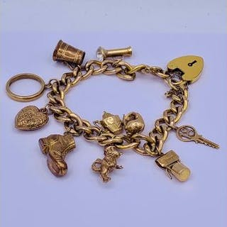 A Rolled gold bracelet with ten hallmarked 9ct gold charms.