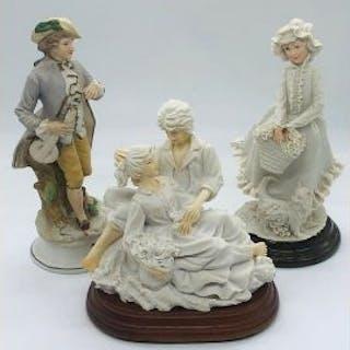 Three porcelain figurines