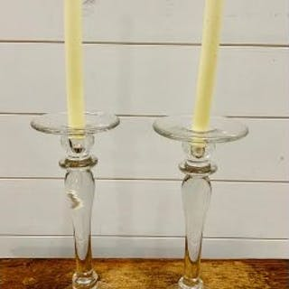 A pair of glass candlesticks
