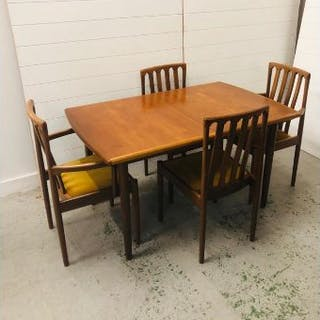 A mid century dining table and four chairs by Meredew (W180/130cm D84cm H70cm)