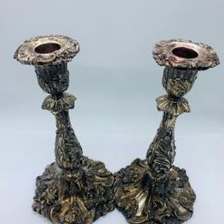 A pair of Victorian silver candlesticks, with indistinct hallmarks.