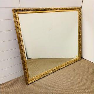 A gilt bevelled edge mirror