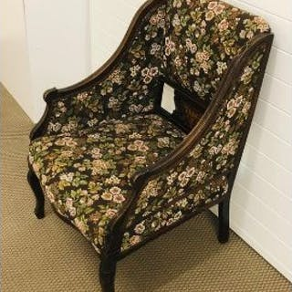 A floral embroidered upholstered armchair with decorative panel with marquetry