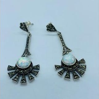 A pair of silver marcasite and opal panelled drop earring