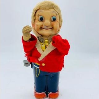A vintage wind up toy of a man