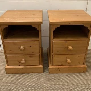 A pair of pine bedsides cabinets with two drawers under