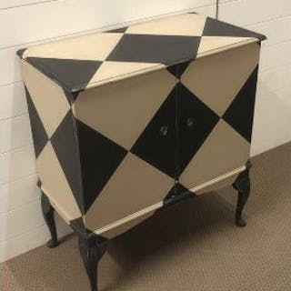 A harlequin hand painted cocktail cabinet with an internal antique mirror back