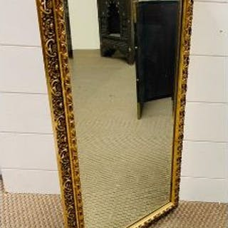 A gilt framed bevelled mirror