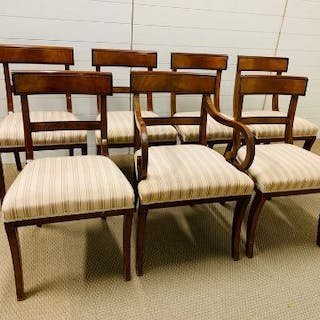 Six regency style chairs with sabre legs and one carver