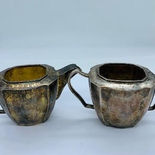 A Sterling silver milk jug and sugar bowl, total weight 500g