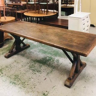 A large oak wake/dining table with eight gothic style oak dining chairs