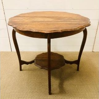 An oak two tiered scalloped edge occasional table