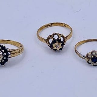 A selection of three 9ct gold rings with diamond and sapphire settings