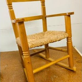 A Childs Pine Rocking Chair