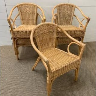 Five rattan stackable chairs