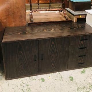 A contemporary Wenge sideboard with four drawers and two cupboards