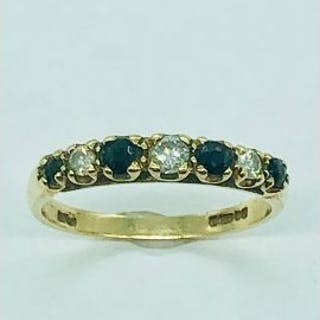 A 9ct gold ring set with four small sapphires and three small diamonds (1.58g)