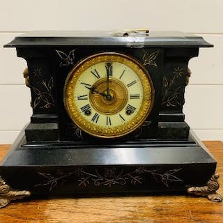 Ansonia iron mantel clock with brass claw feet and dragon brass handles to side