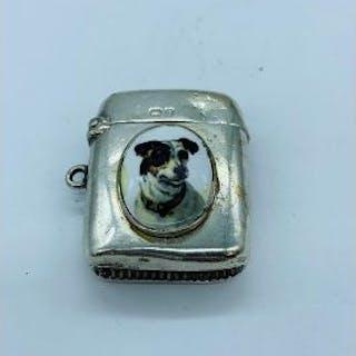 A silver vesta case with enamel plaque depicting a dog