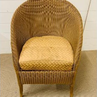 A original Lloyd loom lusty chair in gold